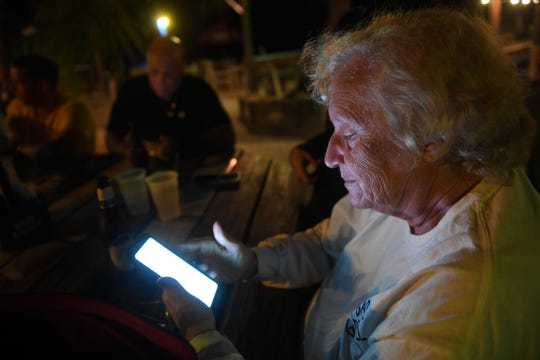 Linda Kinchen refreshes the elections website waiting for results to come in for the Sebastian City Council election on Tuesday, Nov. 5, 2019, at the Tiki Bar in Sebastian. Kinchen, the city's vice mayor, lost her seat on the council along with incumbents Bob McPartlan and Albert Iovino.