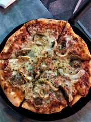 PopStroke serves a 12-inch pizza with your choice of toppings.