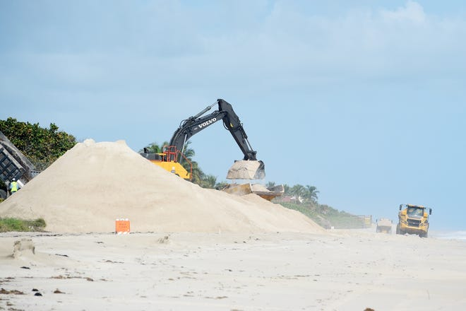 Work crews begin hauling, offloading and distributing sand at Tracking Station Park to reconstruct dune and beach erosion caused by hurricanes Matthew, Irma and Dorian on Wednesday, Nov. 6, 2019, in Indian River County. The Sector 5 project area is a 3.1-mile section of shoreline that extends just north of the Seawatch Condominiums in Indian River Shores, south to the Riomar Golf Course in Vero Beach. The project is expected to be complete by April 30, 2020.