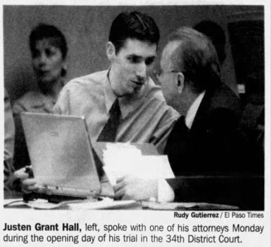 Justen Grant Hall, left, speaks with his attorney during the opening day of his trial in this Jan. 25, 2005, photo.