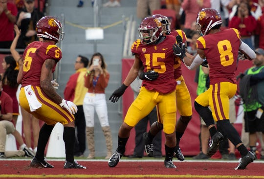Moorpark High graduate Drake London (15) celebrates with his USC teammates after scoring a touchdown against Oregon on Saturday night.