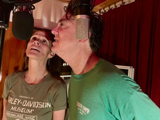 Kelly Zirbes, of band Kelly's Lot, and Doug Pettibone sing during a recording session for nonprofit Totally Local VC's Local Love CD project. Sales of the CD will go to help the victims of the Thomas Fire.