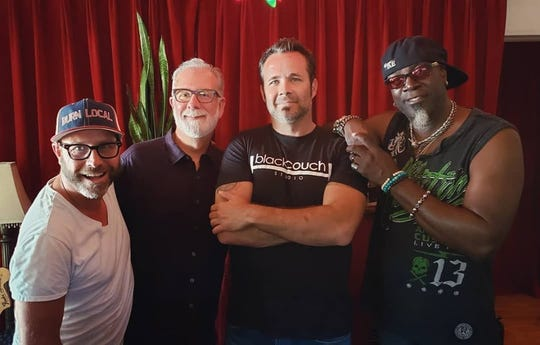 John Baffa, of TV Tray Studios, poses with Guy Martin band members Todd Maroot. Guy Martin and Alvino Bennet. The group took part in nonprofit Totally Local VC's Local Love CD project. Sales of the CD will go to help the victims of the Thomas Fire.