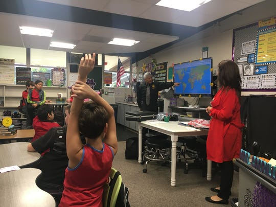 Father Tancredo Pastores Jr. speaks to students in Mrs. Carrillo's class at Royal Oaks Elementary School.