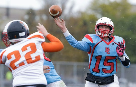 Newman Catholic's Ben Bates (15) passes against Phillips during a game Oct. 12 in Wausau.