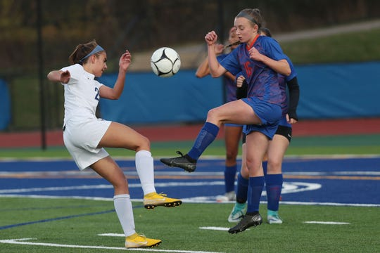 From left, Haldane's Anna Rowe (26) and S.S. Seward's Kelly Morgan (16) battle for ball control during the girls soccer Class C state regional game at Middletown High School Nov. 5, 2019.
