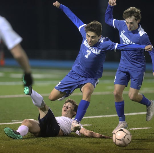 Jimmy Gallo of Bronxville leaps over Kyle Trapp of Burke Catholic during a  NYSPHSAA Class C regional semifinal soccer match at Hendrick Hudson High School in Montrose Nov. 5, 2019. Burke Catholic defeated Bronxville 2-0.