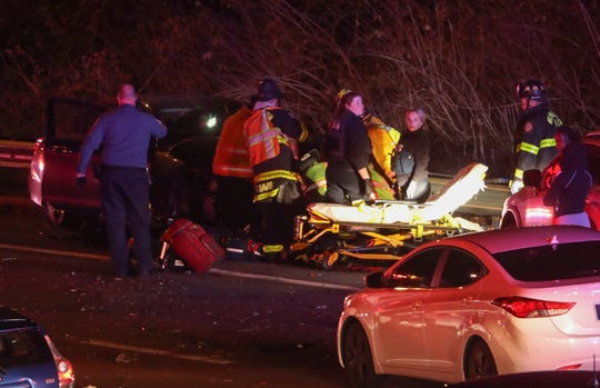 Emergency personnel work at the scene of a serious accident that shut southbound I-95 before the Brandywine River bridge about 11:45 p.m. Tuesday.