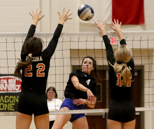 Peaster's Hannah Barry spikes the ball by Nocona's Karlee Brown (22) and Taylor Newmon (11) Tuesday, Nov. 5, 2019, in Chico. The Lady Greyhounds defeated the Lady Indians 3-2 (25-17, 20-25, 23-25, 25-20, 15-9) in the bi-district round of the playoffs.