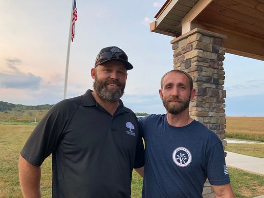 Glenn Rosenbaum, left, Legacy Program Peer Leader serves as mentor to Brant Kanuckel, who participated in the Mighty Oaks Warrior Program leadership training at The Wilds' Cabins at Straker Lake.