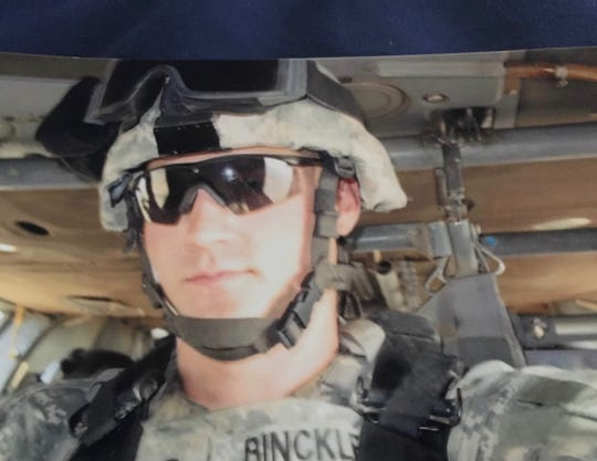 Sgt. Adam Binckley riding in Blackhawk helicopter over Iraq in 2006