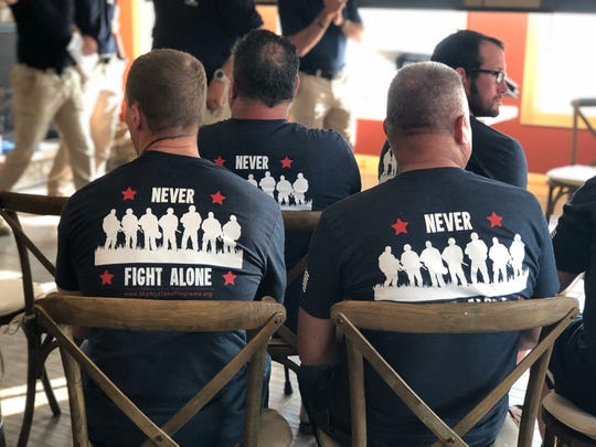 Participants sport T-shirts with a powerful message during their recent graduation from the Mighty Oaks Warrior Programs Legacy Program for Men held at the lodge at Straker Lake at The Wilds.