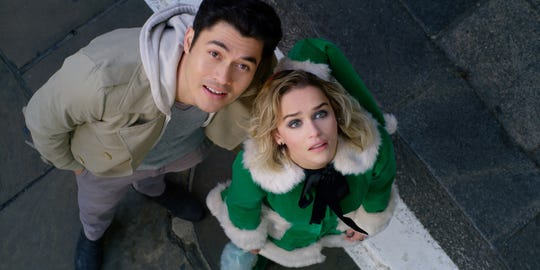 """Tom (Henry Golding) gets Kate (Emilia Clarke) out of a deep funk in """"Last Christmas."""""""