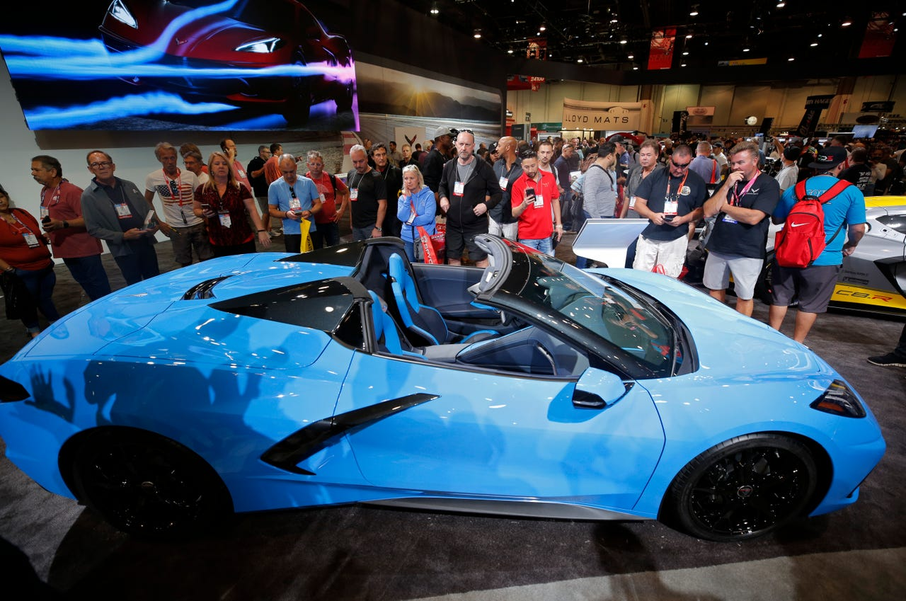 People look at a Chevrolet Corvette Stingray Convertible on display at the Chevrolet booth at the SEMA show on Nov. 5, 2019, in Las Vegas.