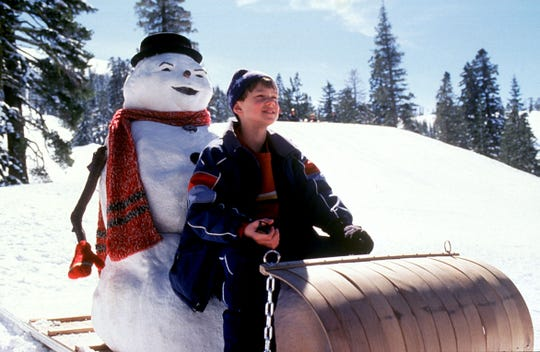 """Charlie Frost (Joseph Cross) goes sledding with the snowman form of his dead dad (Michael Keaton) in """"Jack Frost."""""""