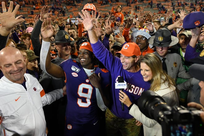 Clemson Tigers head coach Dabo Swinney and running back Travis Etienne  sing the alma mater after defeating the Wofford Terriers at Clemson Memorial Stadium.