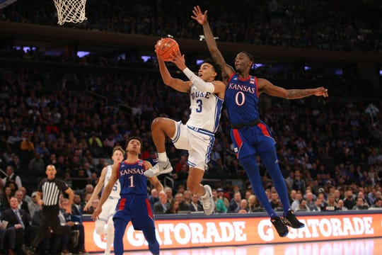 Duke Blue Devils guard Tre Jones (3) drives to the basket against Kansas Jayhawks guard Marcus Garrett (0) during the first half at Madison Square Garden.