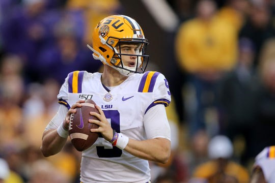 Tigers quarterback Joe Burrow looks to throw against the Auburn Tigers in the second half at Tiger Stadium.