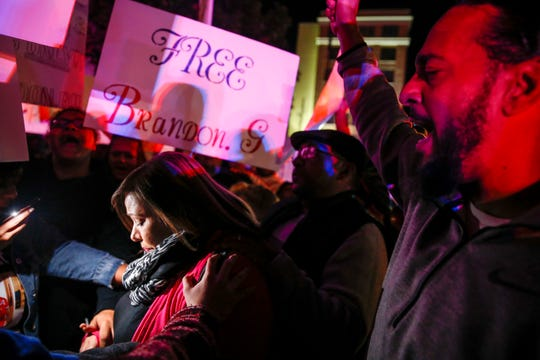 Pamela Lopez, left, is surrounded as she joins demonstrators at the Hunt County Sheriff's Department in downtown Greenville, Texas, calling for the release of her son Brandon Ray Gonzales, 23.  Nov. 2, 2019