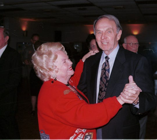 The late Bettie Texada (left), a charter member of the Magnolia Dance Club, smiles at dance partner Jack Newell as they take a turn across the dance floor at one of the club's dances held in 2000.