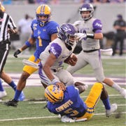 ACU quarterback Sema'J Davis is tackled by a McNeese defender in the first half of the Southland Conference game. ACU won 17-10 on Sept. 21 at Wildcat Stadium.