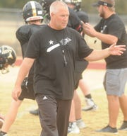 Gordon football coach Mike Reed instructs players during practice Wednesday at Longhorn Stadium.
