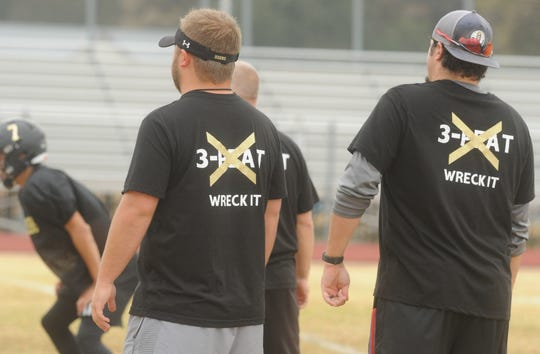 Gordon assistant football coaches Blayton, right, and Bryson Oliver look on as the team runs a play at practice Wednesday at Longhorn Stadium.