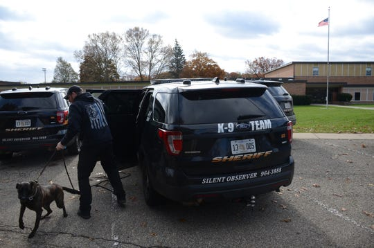 Deputy Dave Winder and his dog, Rocket, trained to search for firearms, prepare to help search the Calhoun Community High School on Thursday.