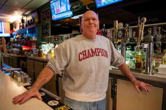 Norm Downey, owner of Lakeview Lounge, poses for a portrait behind the bar on Thursday, Nov. 7, 2019 in Battle Creek, Mich.