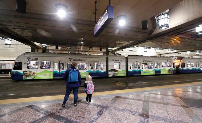 Southbound passengers wait as they look across at a northbound Sound Transit light rail train at an underground station Wednesday, Nov. 6, 2019, in downtown Seattle.