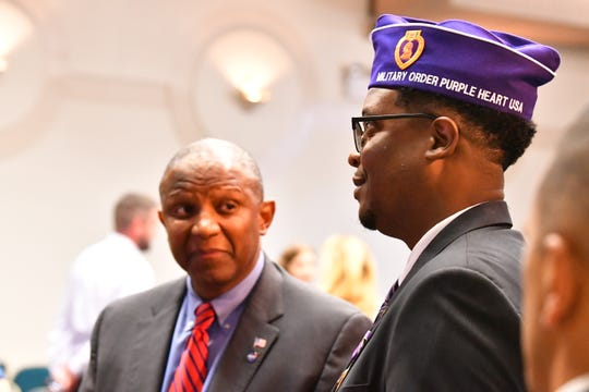 Derrick Matthews ( right) Purple Heart recipient and a KSC PAO, talks with Kelvin Manning, Associate Director of KSC. A ceremony was held at Kennedy Space Center Thursday  naming KSC a Purple Heart Entity in a proclamation by the Military Order of the Purple Heart.