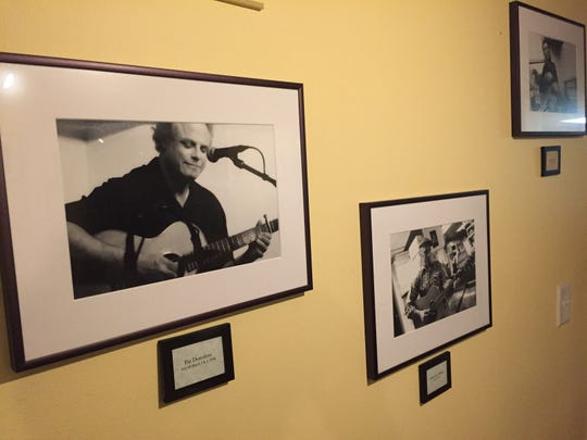 Photos of musicians who have performed at the Good Times Cafe are on display on the walls of the Hinesburg restaurant.