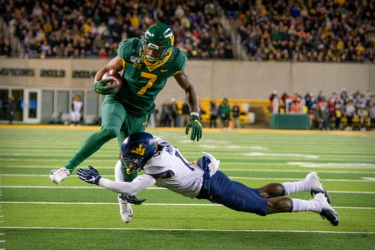 Baylor Bears running back John Lovett (7) tries to leap West Virginia Mountaineers safety Kerry Martin Jr. (15) during the second quarter at McLane Stadium.