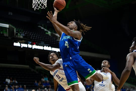 Islanders Jashawn Talton jumps to make a shot during the first half of their game against Louisiana Tech at the American Bank Center on Wednesday, Nov. 6, 2019.