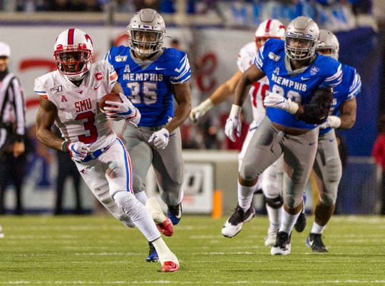 Southern Methodist Mustangs wide receiver James Proche (3) carries the ball against Memphis Tigers linebacker Tim Hart (35) during the second half at Liberty Bowl Memorial Stadium.
