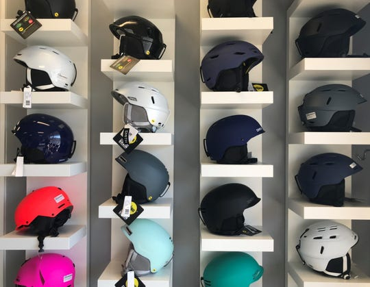 Helmets fill a display area at Danzeisen & Quigley in Cherry Hill.