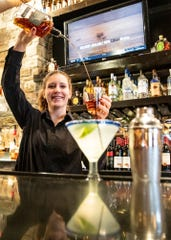 Longhorn Steakhouse bartender Cortney Tackett recently won a regional bartending competition.