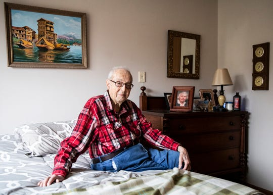 World War II veteran Master Sgt. Wenner A. Botkin sits on his crisply made bed and recounts his time in India and China and serving in the China Burma Indian Theater of the war.