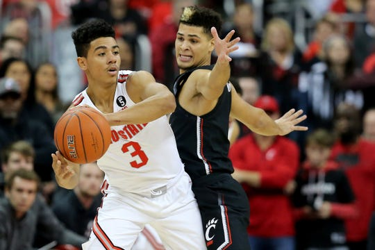 Ohio State Buckeyes guard D.J. Carton (3) looks to pass as Cincinnati Bearcats guard Jaevin Cumberland (21) defends in the first half of a college basketball game, Wednesday, Nov. 6, 2019, at Value City Arena in Columbus, Ohio.