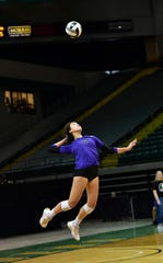 Katelyn Grimes takes to the air for a CHCA serve at the OHSAA Division III girls state volleyball semifinals, Nov. 7, 2019.