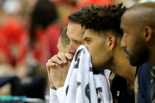 Cincinnati Bearcats head coach John Brannen and Cincinnati Bearcats guard Jarron Cumberland (34) sit on the bench in the second half of a college basketball game, Wednesday, Nov. 6, 2019, at Value City Arena in Columbus, Ohio. The Ohio State Buckeyes won 64-56.