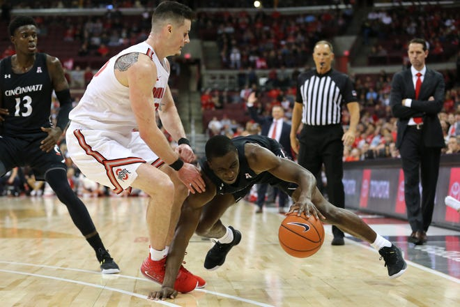 Cincinnati Bearcats guard Keith Williams (2) maintains his dribble as Ohio State Buckeyes forward Kyle Young (25) defends in the second half of a college basketball game, Wednesday, Nov. 6, 2019, at Value City Arena in Columbus, Ohio. The Ohio State Buckeyes won 64-56.