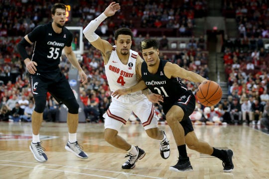 Cincinnati Bearcats guard Jaevin Cumberland (21) drives to the basket as Ohio State Buckeyes guard Duane Washington Jr. (4) defends in the second half of a college basketball game, Wednesday, Nov. 6, 2019, at Value City Arena in Columbus, Ohio. The Ohio State Buckeyes won 64-56.