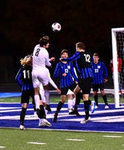 Brady Shapiro (8) of Lakota East lifts a header shot to the goal in hopes of bringing theThunderhawks even with Olentangy Liberty late in the game but the shot is stopped and Lakota East falls 1-0 in the OHSAA Boys Soccer Division I Semifinal, Nov. 6, 2019.