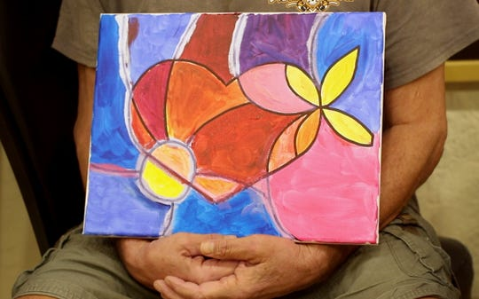 """Rick Stratus, 65, a U.S. Navy veteran, created this abstract painting he calls """"Heart on the Mend."""""""