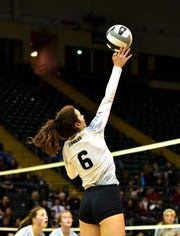 Erin McDaniel of CHCA scores a kill in the OHSAA Division III girls volleyball state semifinals, Nov. 7, 2019.