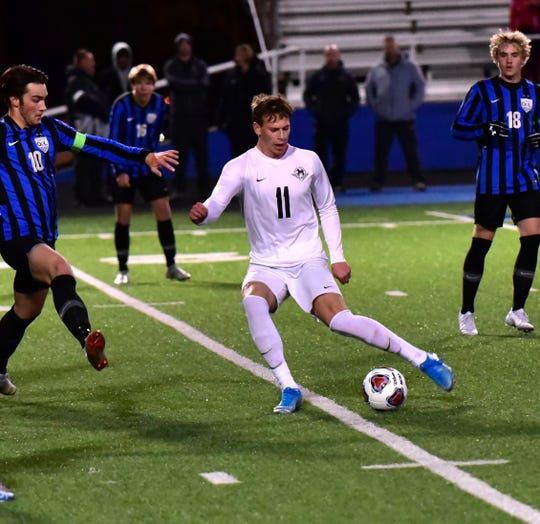 Luke Birdsong (11) moves the ball into scoring position for Lakota East in the OHSAA boys soccer Division I state semifinal, Nov. 6, 2019.