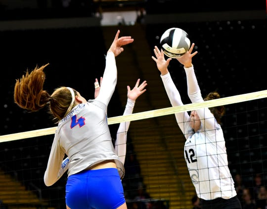 CHCA's Annie Lockett (12) stops a hard Liberty-Benton spike attempt and scores a point in the OHSAA Division III girls volleyball state semifinals, Nov. 7, 2019.