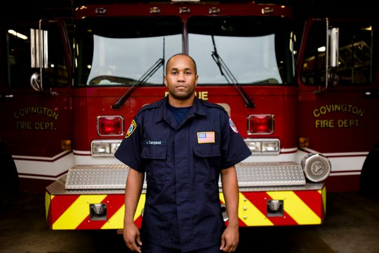 Lt. Joshua Campbell, Covington firefighter and paramedic, stands in front of Rescue 1 inside the Company 1 Fire Station in Covington.