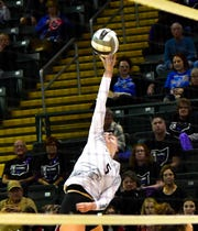 Rylie Wichmann tips back a save for a CHCA score in the OHSAA Division III girls volleyball state semifinals, Nov. 7, 2019.
